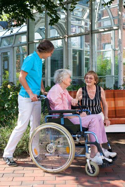 Idős nő tolószék gondozó séta kert Stock fotó © belahoche