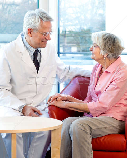 Physician consulting with an elderly woman Stock photo © belahoche