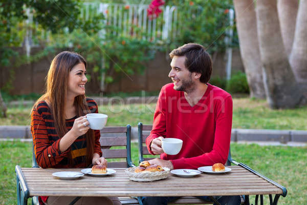 Happy smiling couple having lunch Stock photo © belahoche