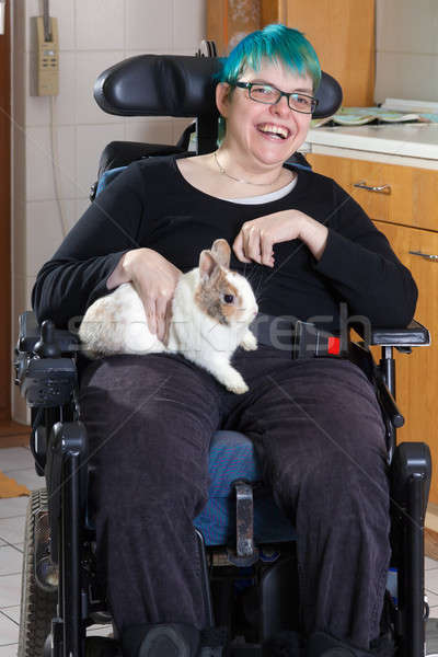 Cheerful young infantile cerebral palsy patient Stock photo © belahoche