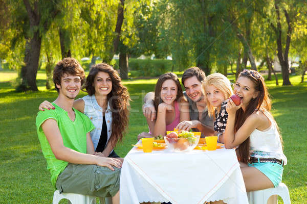 Teenage students having a relaxing meal outdoors Stock photo © belahoche