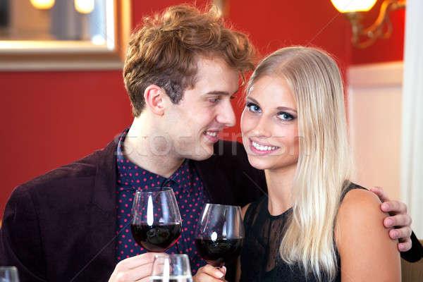 Smiling Romantic Couple Having Wine Stock photo © belahoche