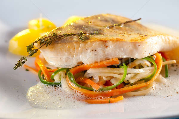 Fried pike perch fillet with vegetables. Stock photo © belahoche