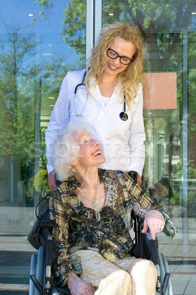 Happy Heath Care Assistant and Elderly Patient Stock photo © belahoche