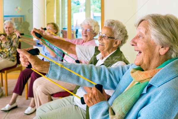 Elderly ladies exercising in a gym Stock photo © belahoche
