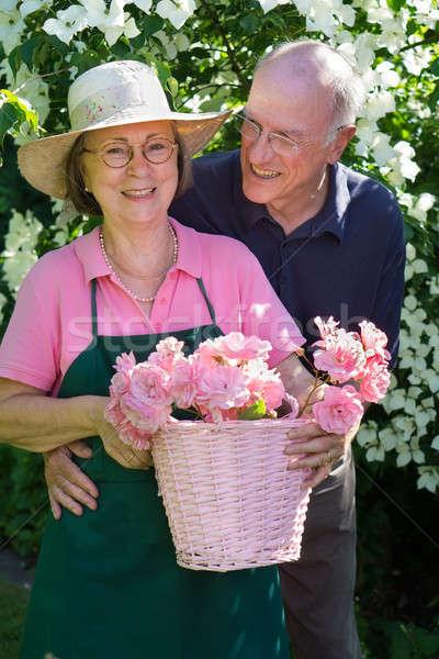 Smiling gardener with attractive man. Stock photo © belahoche