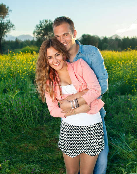 Happy loving attractive young couple Stock photo © belahoche
