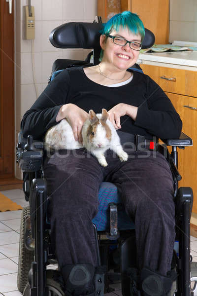Young woman with infantile cerebral palsy Stock photo © belahoche