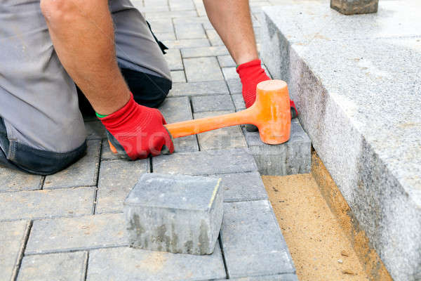 Creating a pavement. Close up.  Stock photo © belahoche