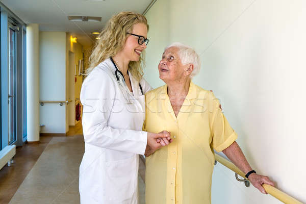 Medical Assistant Assisting Elderly in Hospital Stock photo © belahoche