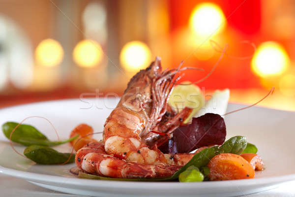 fried scampi with mixed salad and cherry tomatoes Stock photo © belahoche