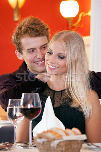 Young Couple Sweet Moments During Dinner Date Stock photo © belahoche