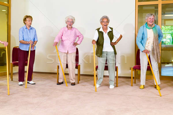 Four elderly females exercising with canes Stock photo © belahoche