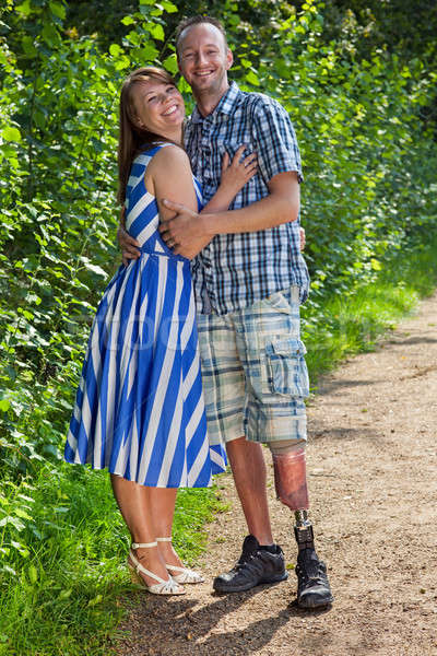 Confident handicapped man with his wife Stock photo © belahoche