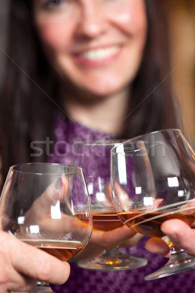 Bril brandewijn partij vrouw uit focus Stockfoto © belahoche