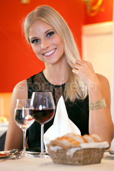 Smiling Woman at Table Having Bread and Wine Stock photo © belahoche