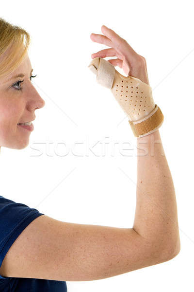 Smiling Blond Woman Wearing Supportive Thumb Brace Stock photo © belahoche