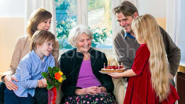 Grandma gets a birthday cake Stock photo © belahoche