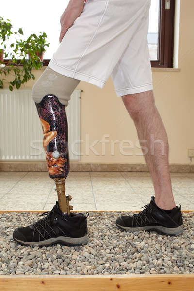 A male prosthesis wearer in a training situation. Stock photo © belahoche