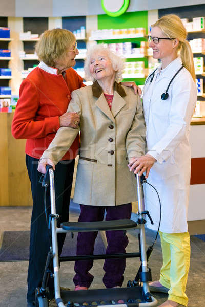 Happy elderly women with walk laughing with doctor Stock photo © belahoche