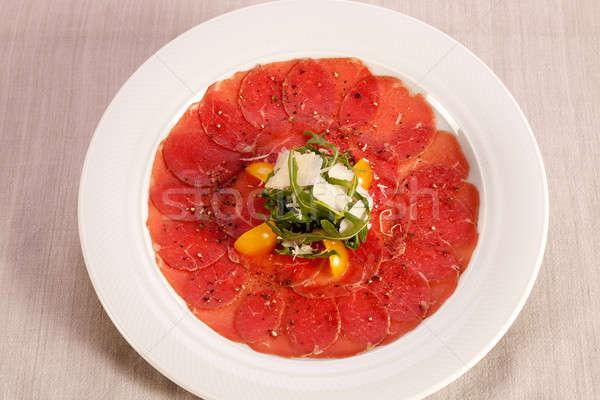 Carpaccio of beef.  Stock photo © belahoche