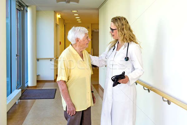 Doctor Talking to Elderly at the Hospital Corridor Stock photo © belahoche