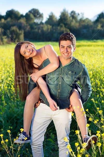 Twee jonge liefhebbers veld Geel aantrekkelijk Stockfoto © belahoche