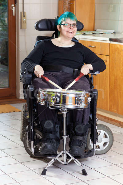 Happy young woman with infantile cerebral palsy Stock photo © belahoche