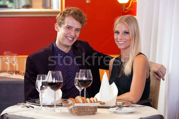 Happy smiling couple enjoying a night out Stock photo © belahoche