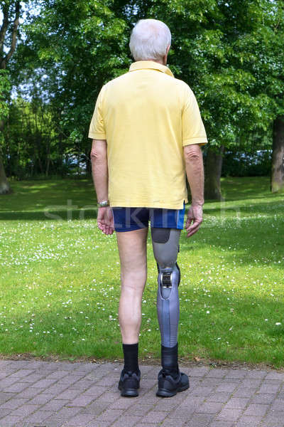 Rear view on man with prosthetic leg Stock photo © belahoche