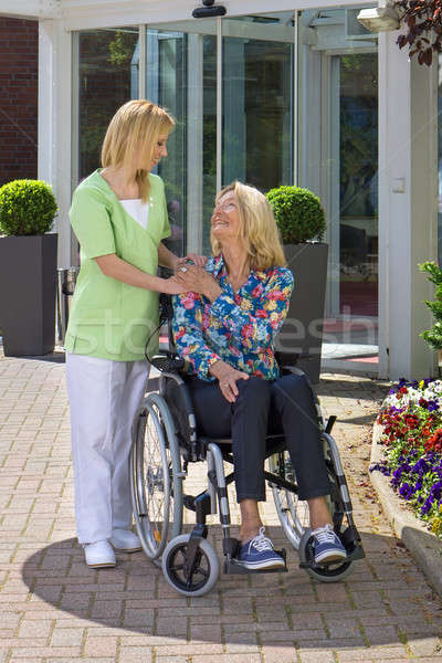 Nurse Showing Care for Senior Woman in Wheelchair Stock photo © belahoche