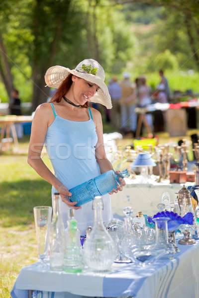 Attractive woman shopping for antiques, Provence, France. Stock photo © belahoche