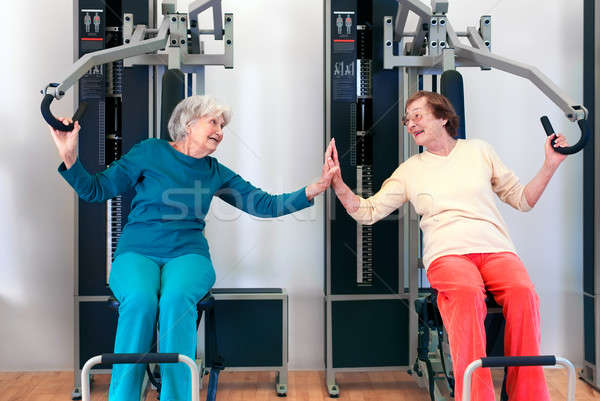 Happy Grannies Enjoying Chest Press Exercise Stock photo © belahoche