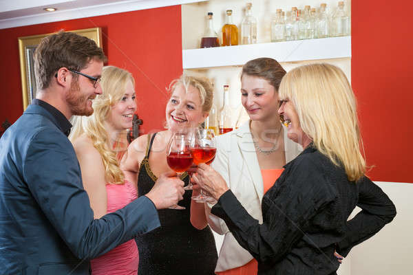 Group of friends celebrating with rose wine Stock photo © belahoche