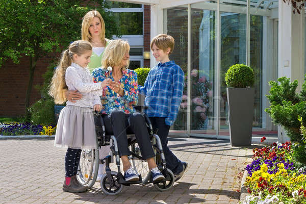 Grandchildren visiting grandmother in wheelchair Stock photo © belahoche