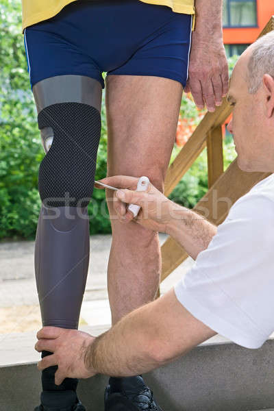 Therapist adjusting prosthetic leg Stock photo © belahoche
