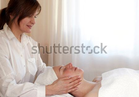 Beauty Therapist Doing Facial Massage Stock photo © belahoche