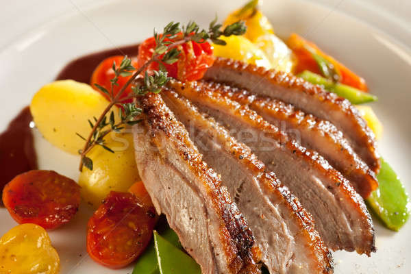 Stock photo: Roasted duck in port wine sauce.