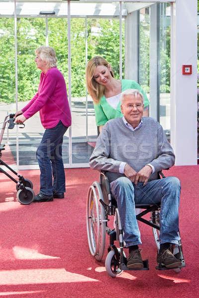 Nővér toló idős férfi tolószék lobbi Stock fotó © belahoche