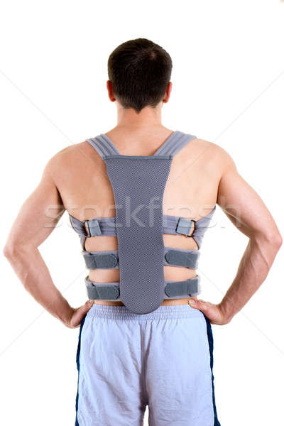 Athletic Man Wearing Supportive Back Brace Stock photo © belahoche