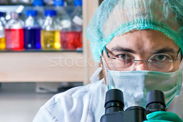 Male scientist working in a laboratory.  Stock photo © belahoche