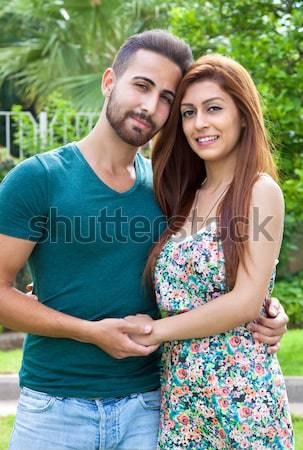 Afetuoso casal em pé braço atraente Foto stock © belahoche