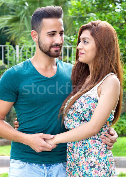 Loving couple looking into each others eyes Stock photo © belahoche