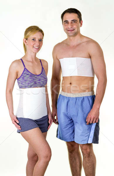 Athletic Man and Woman Wearing Back Support Braces Stock photo © belahoche