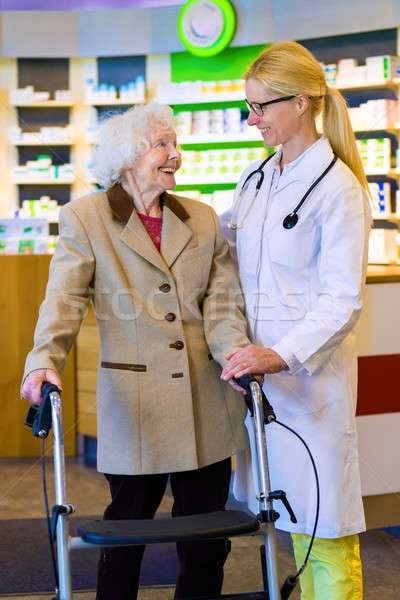 Friendly doctor with patient using walker Stock photo © belahoche