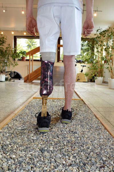 Male prosthesis wearer training to walk Stock photo © belahoche