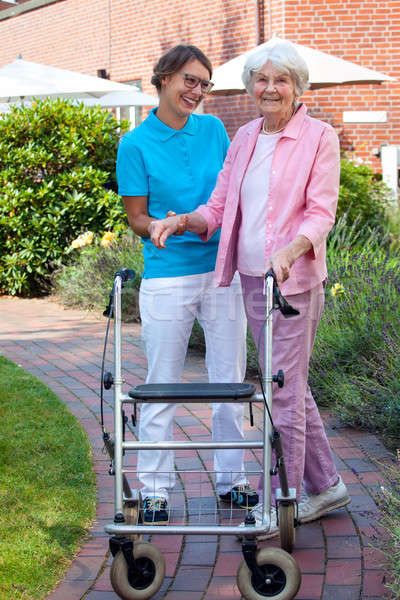 Care assistant helping an elderly lady Stock photo © belahoche