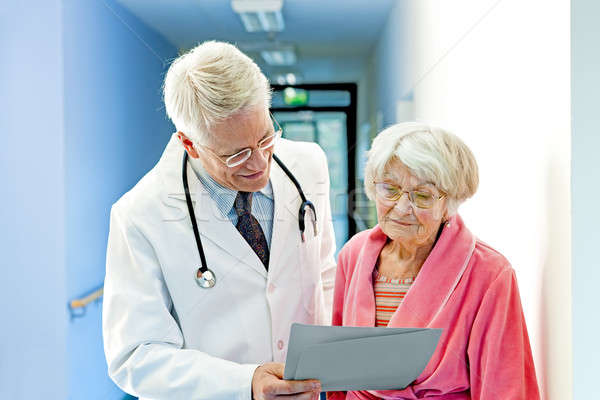 Doctor Shows Female Elderly Patient Results Stock photo © belahoche