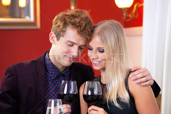 Pretty Sweet Lovers Holding Glass of Wines Stock photo © belahoche