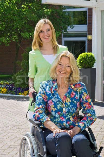 Retrato enfermeira senior mulher cadeira de rodas loiro Foto stock © belahoche